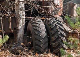 Pripyat, Ukraine, 2021 -Tractor tires in Chernobyl photo