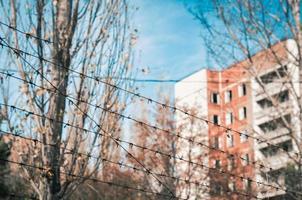 Pripyat, Ukraine, 2021 - Building behind bared wire in Chernobyl photo