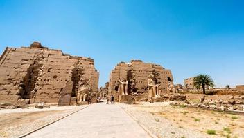 Luxor, Egypt, 2021 - Tourists viewing the Karnak Temple photo