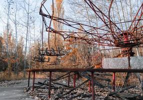 Pripyat, Ukraine, 2021 - Carousel in an abandoned amusement park in Chernobyl photo