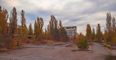 Pripyat, Ukraine, 2021 - Empty parking lot and buildings in Chernobyl photo