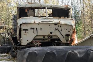 Pripyat, Ukraine, 2021 - Old vehicle in the Chernobyl forest photo