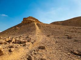 small mountain in the desert photo