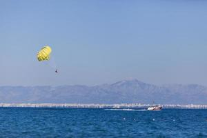 BELDIBI, TURKEY, OCTOBER 7 - Unidentified people parasailing at Beldibi at October 7, 2013. Parasailing is popular on the coastal area of Turkey and almost all main hotels has parasailing activity. photo