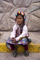 CUSCO, PERU, DECEMBER 31, 2017 - Unidentified girl on the street of Cusco, Peru. Almost 29 percent of Cusco population have less than 14 years. photo