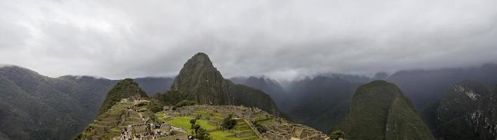 MACHU PICCHU, PERU, JANUARY 3, 2018 - Unidentified people at remains of ancient Inca citadel in Machu Picchu, Peru. Almost 2500 tourists visit Machu Picchu every day. photo