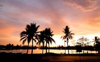 Sunset on the lake splash beautiful orange light photo