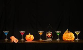 Halloween pumpkin and wine glass photo