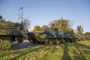 BELGRADE, SERBIA, OCTOBER 10, 2014 - Unidentified serbian soldiers in BVP M-80A Infantry Fighting Vehicles of Serbian Armed Forces as preparation for 70th anniversary of Belgrade liberation in WWII. photo