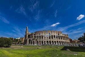 ROME, ITALY, SEPTEMBER 24, 2016 - Unidentified people by Colosseum in Rome, Italy. It was opened at 80AD and is the largest amphitheatre ever built. photo