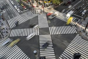 TOKYO, JAPAN, OCTOBER 12, 2016 - Unidentified people crossing the busy street in Ginza, Tokyo.It is a popular upscale shopping area of Tokyo. photo