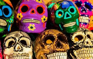 CABO SAN LUCAS, MEXICO, AUGUST 8, 2014 - Calacas, wooden skull Day of the Dead masks on market in Cabo San Lucas, Mexico. Masks are typical symbols representing calacas - skeletons. photo