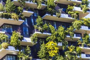 MILAN, ITALY, APRIL 28, 2017 - Detail of the Bosco Verticale in Milan, Italy. It is a pair of residential towers in the Porta Nuova district of Milan that host more than 900 trees. photo