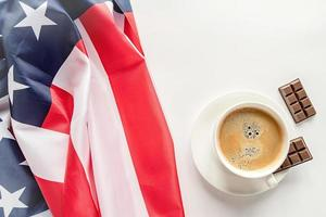 cup of coffee and chocolate with usa flag isolated on white background photo