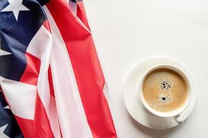 cup of coffee with usa flag isolated on white background photo