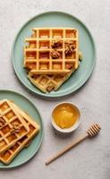 sweet waffles with honey top view flat lay photo