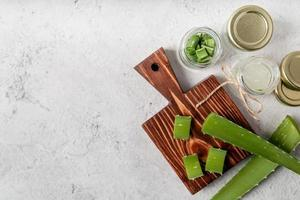 Top view of aloe vera slices on a cutting board with copy space photo