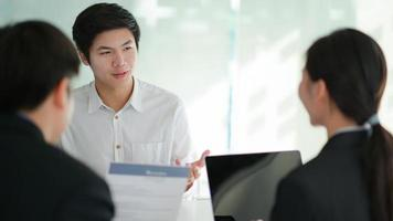 Concept of applying for work, Interviewing job seekers presenting their resume for executives to consider. photo