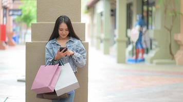 Asian female shoppers are using a smartphone to search for product information. photo