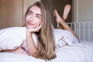 selective focus on face - Pretty white girl dreaming on bed at her room, good female sleep concept, life style photo