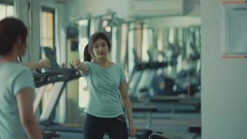 Asian cute girl She is practicing dancing to the rhythm of her favorite song. In front of the mirror at the fitness center video