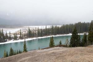 Beautiful aerial view of the river and forest around with snow. Banff National Park, Alberta, Canada photo