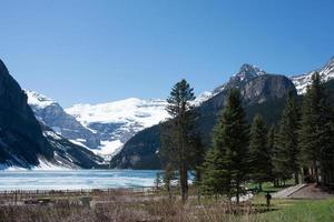 Beautiful landscape with Lake Louise and snowed mountains around. Spring at Banff National Park, Alberta, Canada. photo