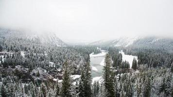 Beautiful canadian landscape in winter with snow, forest and lake. Aerial view of Banff National Park photo