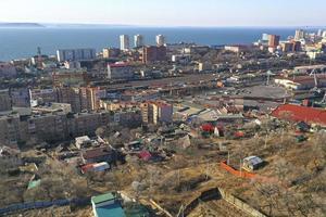Vladivostok, Russia. Urban landscape against the blue sky. photo