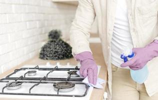 man disinfecting stove photo