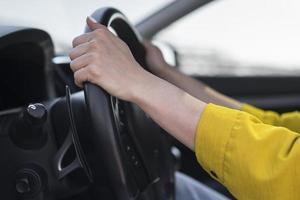 close up hands steering wheel photo