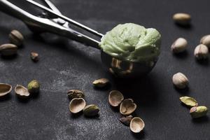 close up tasty pistachio ice cream scoop photo