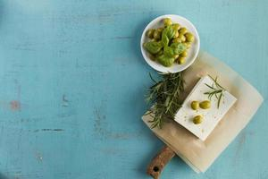 blue background  olives cheese aromatic herb photo