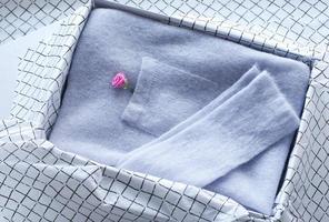 Knitted cardigan in pastel color, garment details, jacket pocket. photo