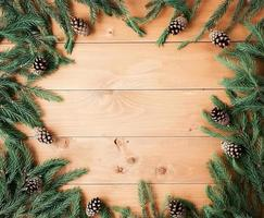 Christmas background with decorations on wooden board. photo