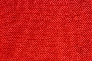 fondo de punto. textura de punto. una muestra de tejido de lana. patrón de tejer foto