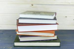 Old books on a wooden shelf. No labels, photo