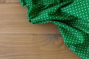 Checkered napkin on wooden background, Home comfort. photo