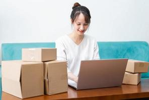 Asian woman portrait at home and online business photo