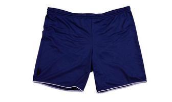 Dark blue sport shorts isolated on white, running shorts close up . photo