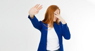 Young red hair woman making a rejection pose and facepalm on a white background. Negative human emotion face expression feeling body language photo