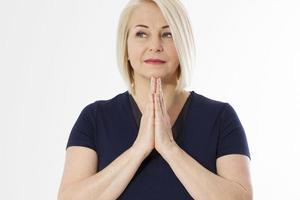 Praying woman portrait over white background copy space photo