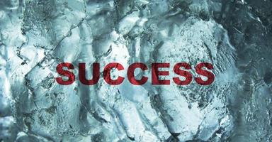 The Success word behind the ice wall background. Bussiness concept. photo