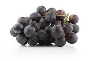 Grape cluster on white photo