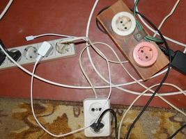 Old plugs and sockets for connecting electronic household appliances photo