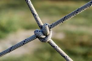 lots of ropes and a big knot photo