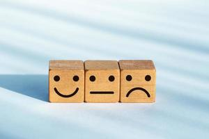 Service evaluation concept. Feedback rating. Smiley icon on wooden dice photo