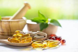 Alternative medicine nature herbal organic capsule, drug with herbs leaf natural supplements for healthy good life. photo