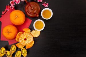 Flat lay Chinese new year mandarin orange and tea water photo