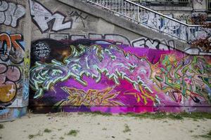 VIENNA, AUSTRIA, FEBRUARY 5, 2014 - View at graffiti on the wall in Vienna. City of Vienna with project Wienerwand Vienna Wall offers young artists from the graffiti scene legal areas for their art. photo